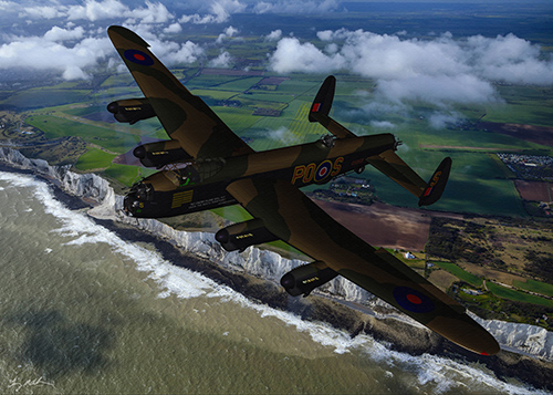 RAF Avro Lancaster over the White Cliffs of Dover: A RAF Avro Lancaster over the Channel and the White Cliffs of Dover. 