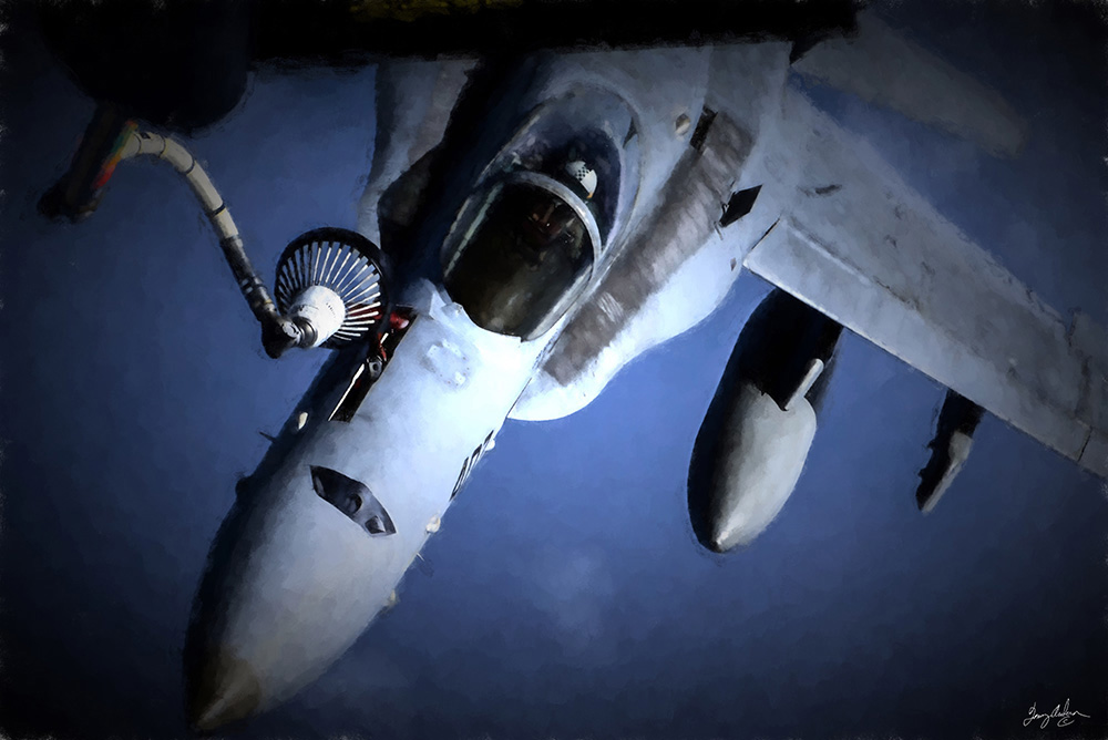 A Thirtsy Hornet: A F/A-18 hornet is refueled in mid-flight.